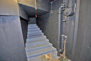 Basement stairs cupboard