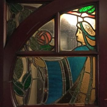 Edwardian stained glass doors closeup at Stalls level