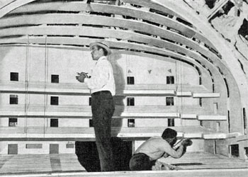 Radio City Music Hall architects at work in a model of the music hall