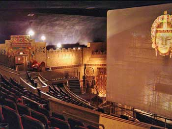 "The theatre just prior to reopening in 2006, when it had a iWERKS ""Extreme"" screen which retracted into the flattened portion of the atmospheric ceiling. Note the Wurlitzer organ console at House Right.  Photo courtesy Mark Demmin II (JPG)"