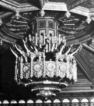 Promotional photo of the Fox Theatre featuring a kickline with accordionist in the central chandelier (JPG)