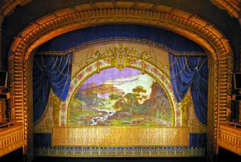 The historic Fire Curtain, photographed in February 2007 by Projectionist John Stewart. John has many more Paramount photos at https://www.flickr.com/photos/12335678@N00/.